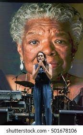Bouckaert Farms, Chattahoochee Hills, Fairburn, Georgia, US - Oct 2,2016: Rosario Dawson speaks onstage at Many Rivers to Cross Music Festival. Maya Angelou onscreen in background.