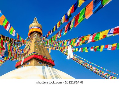 Boudha, bodhnath or Boudhanath stupa with prayer flags, the biggest buddhist stupa in Kathmandu city - on the stupa white dome has eyes and nose painting that mean the Wisdom eyes and Nirvana.