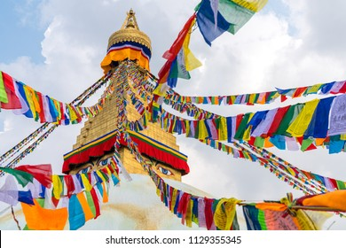 Boudhanath Stupa and prayer flags in Kathmandu, Nepal. Buddhist stupa of Boudha Stupa is one of the largest stupas in the world
