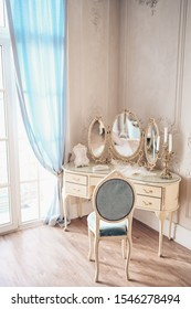 Boudoir dressing table for modern princess. Details of bedroom interior for women. Make-up, hairstyles working zone with mirror