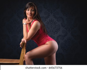 Boudoir photo from a middle aged beautiful woman in elegant room
