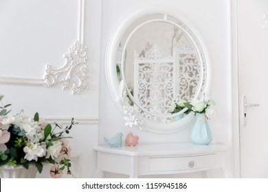 Boudoir table. Details of interior bedroom for girls and make-up, hairstyles with mirror