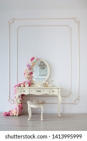 Boudoir table. Details of the interior of the modern classical bedroom for girls and make-up, hairstyles with a mirror
