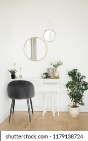 Boudoir table with a mirror and a chair. Interior details. Hugge. Furniture.