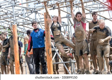 Boughton House, Northamptonshire/UK - May 30, 2015:   Tough Mudders grip the bars at the Funky Monkey obstacle at the Tough Mudder extreme sport challenge raising funds for Help for Heroes.