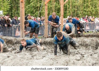 Boughton House, Northamptonshire/UK - May 31, 2015:  People endure shock treatment of the electroshock therapy obstacle at the Tough Mudder extreme sport challenge raising funds for Help for Heroes.