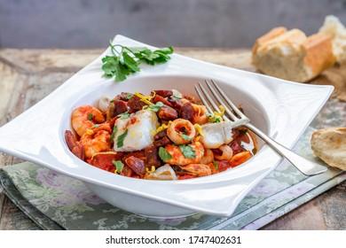 Bouillabaisse (a traditional Provençal fish stew) with crispy chorizo and lemon