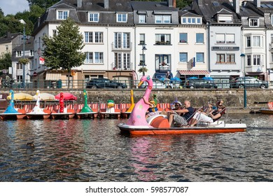 BOUILLON, BELGIUM - AUGUST 18, 2016:  River Semois with family relaxing in pedalo in Belgian Bouillon