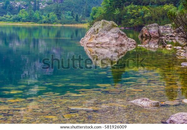 Boulder bouncing in a mountain lake.