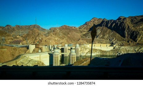 Boulder City, Nevada, USA - September 18, 2017: Hoover Dam is a concrete arch-gravity dam in the Black Canyon of the Colorado River, on the border between the U.S. states of Nevada and Arizona