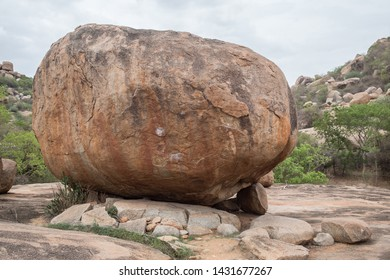 A boulder with climbing chalk on it in Hampi, India, on a late afternoon