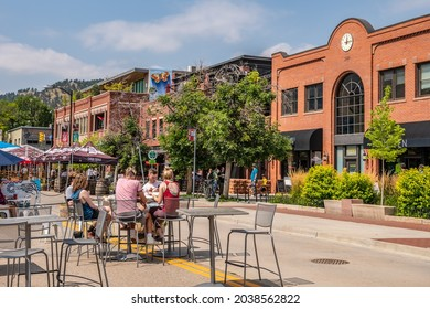 Boulder, CO - August 29, 2021: People enjoy outdoor dining on Pearl Street, downtown.