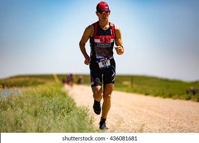 Boulder, CO -- June 11, 2016: Age-group triathlete Kyle Welch (Sunnyvale, CA) runs to a win in the male 55-59 age-group, 4:46:33, at the Ironman 70.3 Boulder.