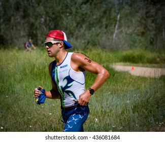 Boulder, CO -- June 11, 2016: Colorado pro Chris Leiferman runs a 1:15:40 half-marathon split to finish second overall, 3:42:39, at the Ironman 70.3 Boulder.