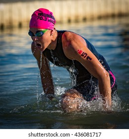 Boulder, CO -- June 11, 2016: Ellie Salthouse leads the pro women out of the water in 26:33 en route to her victory, 4:11:43, at the Ironman 70.3 Boulder.