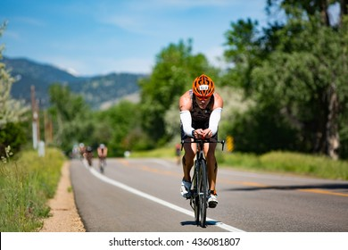 Boulder, CO -- June 11, 2016: Age-group triathlete Ben Fenton of Boulder leads a line of cyclists along Neva Road during the Ironman 70.3 Boulder.