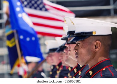 BOULDER, CO - May 25th, 2015 - US Military service men stand in formation for the national anthem during the Bolder Boulder 10K Memorial Day service at Colorado University's Folsom Field