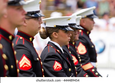BOULDER, CO - May 25th, 2015 - US Military service men and women stand in formation for the national anthem during the Bolder Boulder 10K Memorial Day service at Colorado University's Folsom Field.