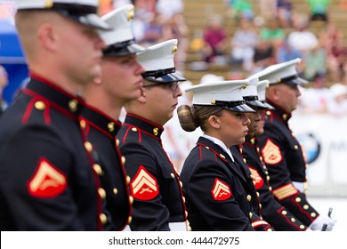 BOULDER, CO - May 30th, 2016 - US Military service men and women stand in formation for the national anthem during the Bolder Boulder 10K Memorial Day service at Colorado University's Folsom Field