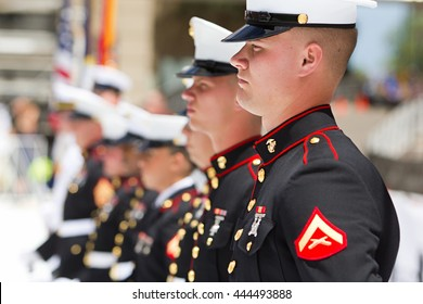 BOULDER, CO - May 30th, 2016 - US Military service men stand in formation for the national anthem during the Bolder Boulder 10K Memorial Day service at Colorado University's Folsom Field