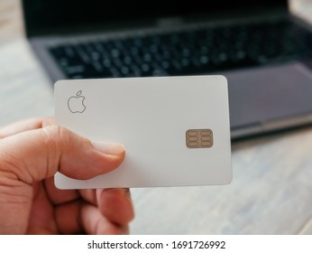 Boulder, CO / USA - April 2, 2020: Physical Apple Credit Card Titanium with MacBook Pro ready to make an online purchase. Apple is a multinational technology company.