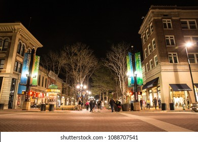 BOULDER, COLORADO - APRIL 27, 2018:  Night scene along popular Pearl Street Mall with people and lights in downtown Boulder Colorado