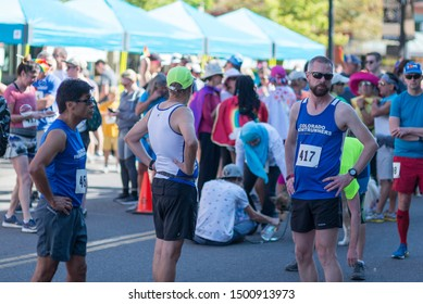 Boulder, Colorado / United States of America - September 8th, 2019 : Runners gather towards the start line of the Rainbow Run Walk 5k, part of Boulder Pridefest.