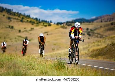 Boulder, Colorado, USA - August 7, 2016: Cyclists ride along Neva Road at Ironman Boulder.