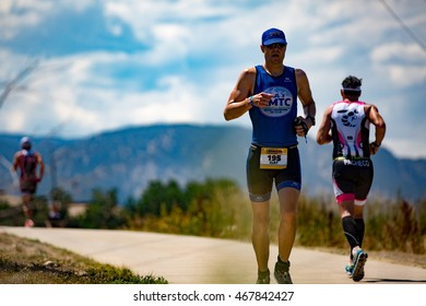 Boulder, Colorado, USA - August 7, 2016: Clay Rahn on the run at Ironman Boulder.