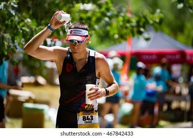 Boulder, Colorado, USA - August 7, 2016: Craig Depperschmidt cools off during Ironman Boulder.