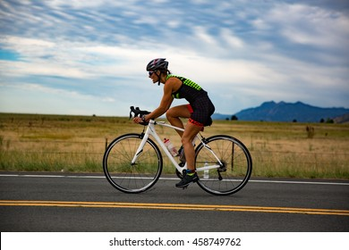 Boulder, Colorado, USA - July 24, 2016: A triathlete bikes along Nelson Road during Tri Boulder.