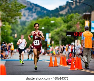 Boulder, Colorado, USA - July 28, 2016: Matt Harrigian of Las Cruces, New Mexico, runs to second overall in the open division of the West End 4K along Pearl Street in downtown Boulder.