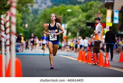 Boulder, Colorado, USA - July 28, 2016: Melissa Mazzo of Boulder runs to victory in the women's open division at the West End 4K along Pearl Street in downtown Boulder.