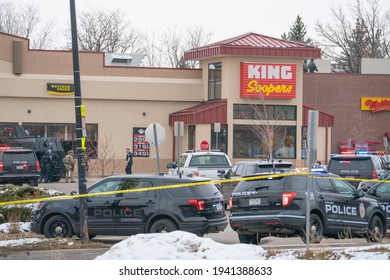 Boulder, Colorado USA - March 22, 2021: Police and SWAT officer in front of King Soopers - the scene of a mass shooting