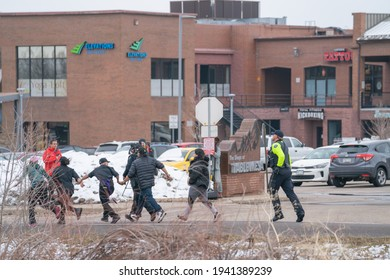 Boulder, Colorado USA - March 22, 2021: Workers holding hands and being led away from an active shooter crime scene at King Soopers - the scene of a mass shooting
