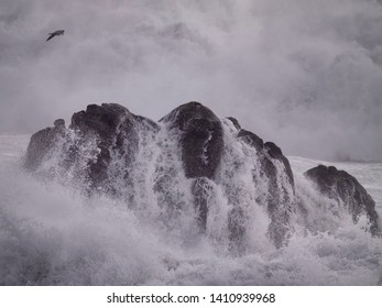 Boulder hit by stormy sea. Northern portuguese coast.