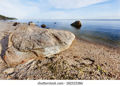 Boulder lying by the seashore of the Peconic bay. Long Island, New York.