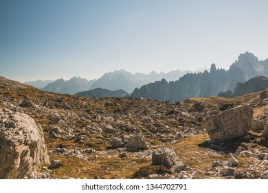 Boulder and scree field in tre cimes di lavaredo national park in italian dolomites europe with mountain peaks in background.