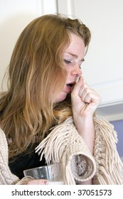 BOULDER - SEPT 14: A 15-year old girl coughs as she tries to recover from Tamiflu on September 14, 2009 in Boulder. The child is trying to recover from Influenza A subtype, H1N1.