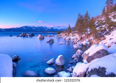 Boulders in Lake Tahoe at sunset.