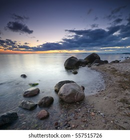 Boulders on Sand Beach at Sunset, Baltic Sea, Rugen Island, Germany