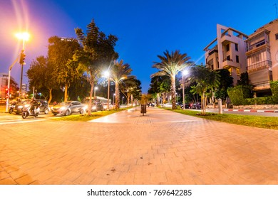 Boulevard Rothschild illuminated in the evening, Tel Aviv, Israel.