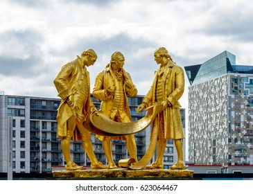 Boulton, Watt and Murdoch Statue in Birmingham against Cloudy Sky Shallow Depth of Field