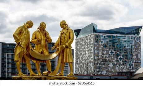Boulton, Watt and Murdoch Statue in Birmingham against Modern Architecture Shallow Depth of Field