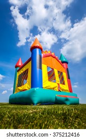 Bounce house inflatable jump castle in yard.