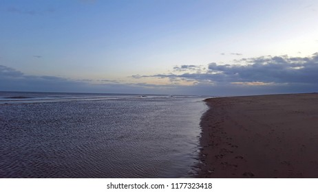 boundary or balance. Sea, beach and sky in Skegness, UK
