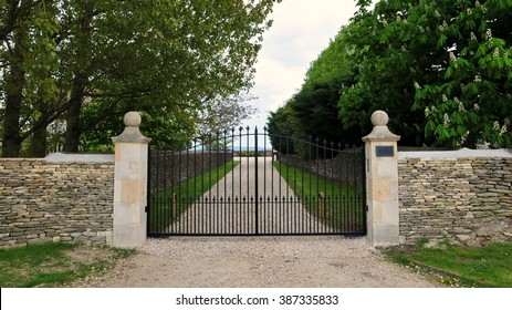 Boundary Wall and Metal Gates of a Country Estate Driveway
