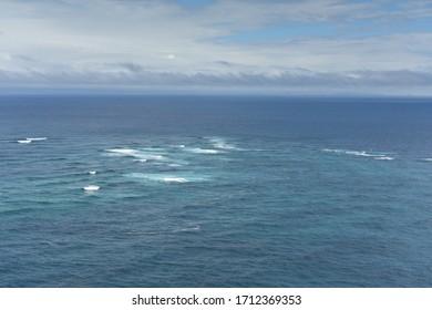 Boundary where the Tasman Sea meets the Pacific Ocean at Cape Reinga, New Zealand