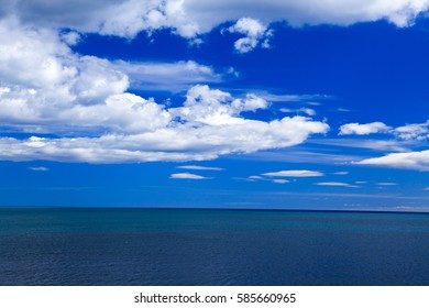 The boundless blue sea and blue sky with clouds in Spain