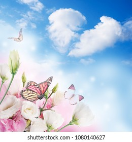 A bouquet of amazing eustoma on a background of a blue sky with colorful butterflies. Flowers.